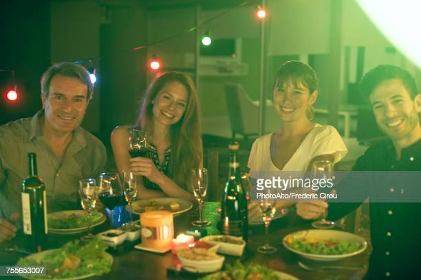 People having dinner together outdoors