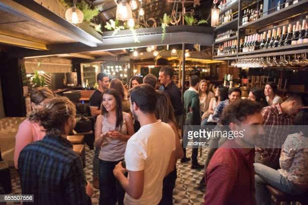 people having drinks at a bar - cocktail party stock pictures, royalty-free photos & images