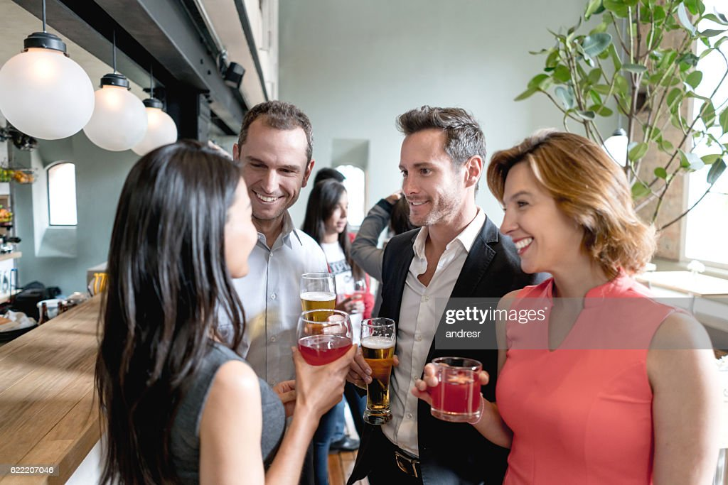 People having drinks at a restaurant : Stock Photo