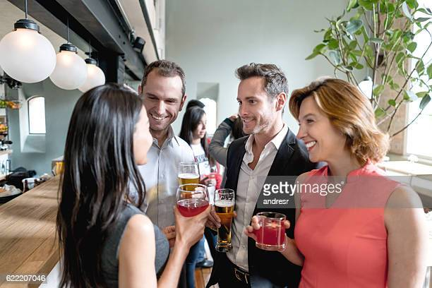 people having drinks at a restaurant - wiedersehenstreffen stock-fotos und bilder