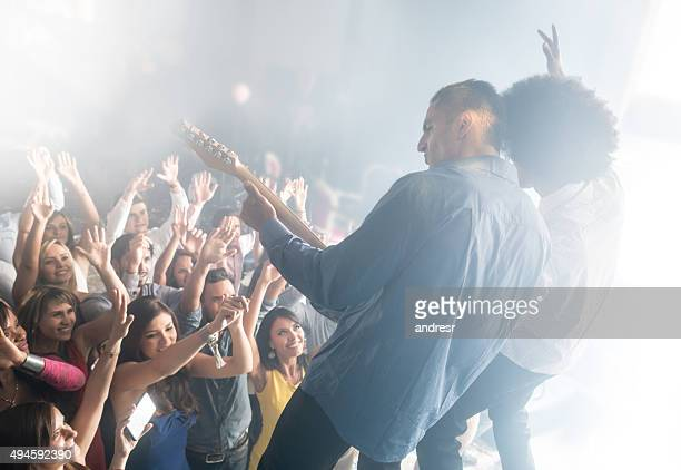 people having fun at a concert - stars and strings concert stock photos and pictures