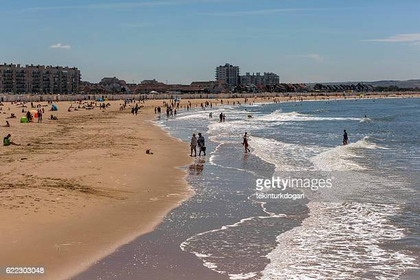 people having fun at sandy beach in calais france - calais stock pictures, royalty-free photos & images