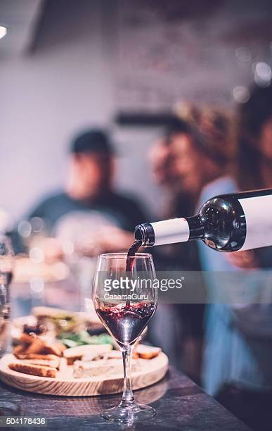 people having fun in a wine bar - food and drink stock pictures, royalty-free photos & images