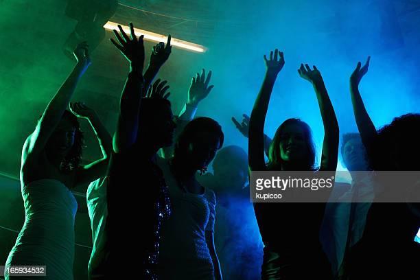 People having fun on dance floor at a night club