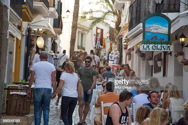 People having fun on the bar terraces in the Dalt Vila in Ibiza island