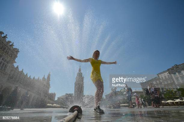 People having fun playing with a water sprinkler in Krakow's Main Square as temperatures reach 37 degrees today The hit wave that was already lasted...