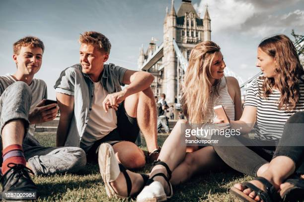 people having fun together in a public park - person in education stock pictures, royalty-free photos & images