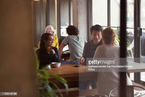 people having informal meeting in co-working space - photography stock pictures, royalty-free photos & images