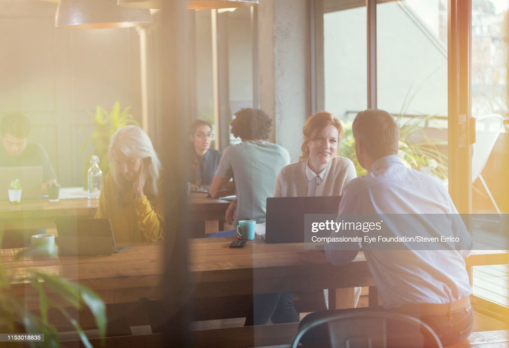 People having informal meeting in co-working space : Stock Photo