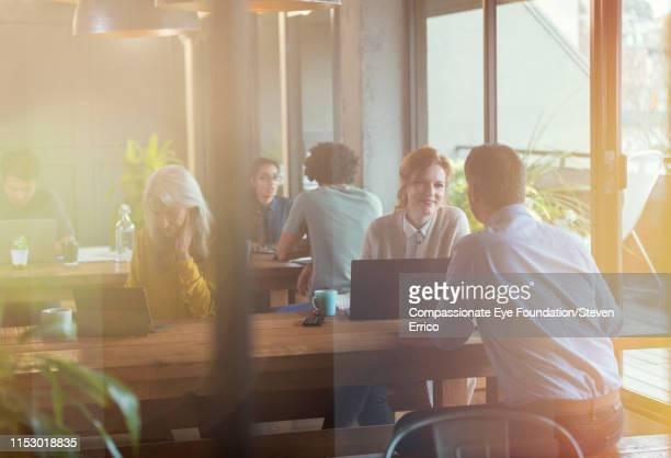 People having informal meeting in co-working space