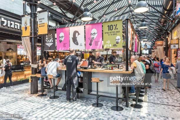 People having lunch at Sarona market april 8th 2017 Tel AvivYafo Israel