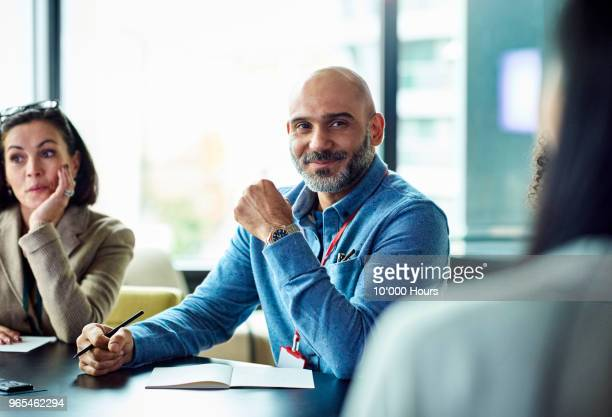 people having meeting in office - asian 50 to 55 years old woman stock photos and pictures