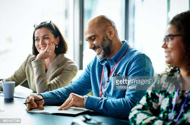 people having meeting in office - colleague stock pictures, royalty-free photos & images