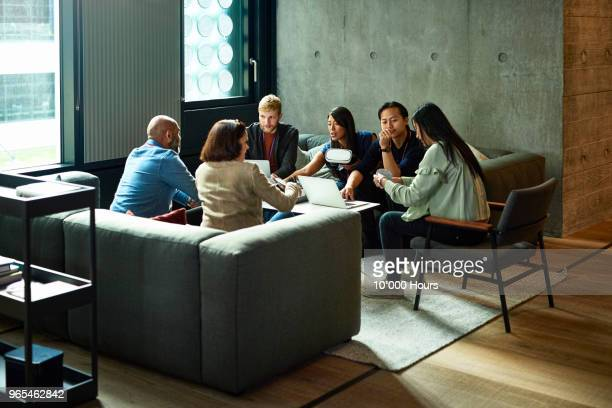 people having meeting in office - coworking stock photos and pictures