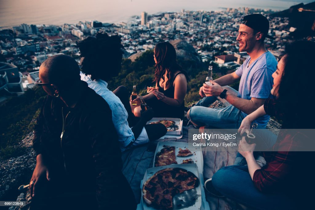 People Having Picnic At Sunset : Stock Photo