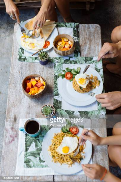 people having traditional balinese meal - balinese culture stock pictures, royalty-free photos & images