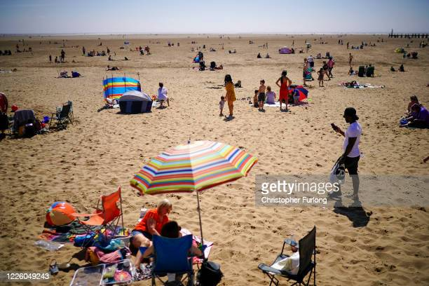 People head to Lytham St Annes beach as England basks in sunshine on May 20 2020 in Blackpool United Kingdom Parts of the country were expected to...