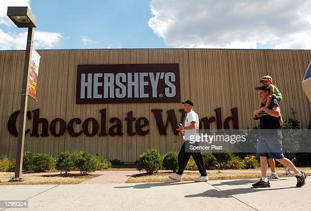 People head to the Hershey store August 7 2002 in Hershey Pennsylvania The Hershey Trust said Wednesday after a special meeting of its board that it...