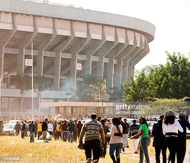 People head to the National Sport Stadium in Harare to watch a friendly football match opposing Zimbabwe to Brazil on June 2 2010 in Harare The...