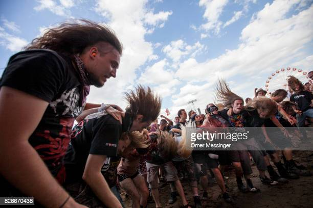 People headbang during a concert at the 2017 Woodstock Festival Poland on August 4 2017 in Kostrzyn Poland The threeday rock music festival now in...