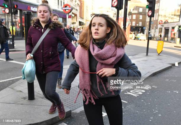 People heading away from the vicinity of Borough Market in London after police told them to leave the area following an incident on London Bridge