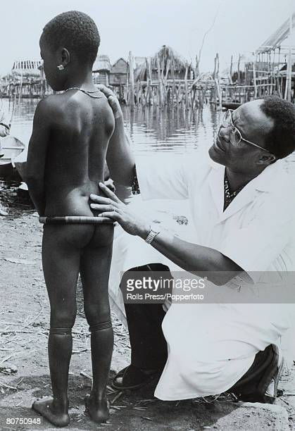 1968 Dahomey A boy of the Mina tribe is checked over by a doctor working on a UNICEF supported assignment