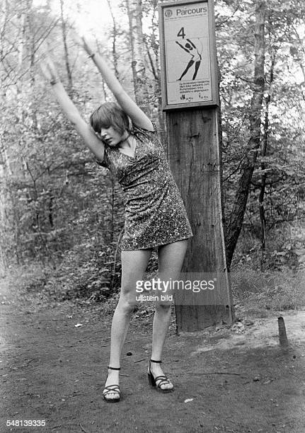 People, health, young woman on a keep-fit trail in the forest, gymnastic exercises outdoors, aged 20 to 25 years, Monika -