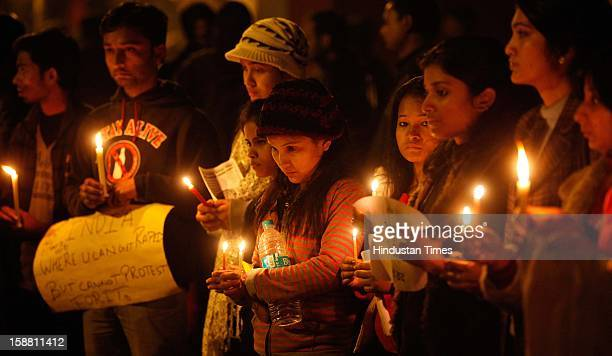 People held Candle Light silent March during the protest at Jantar Mantar to mourn for girl who died of injuries after brutally gang raped in a...