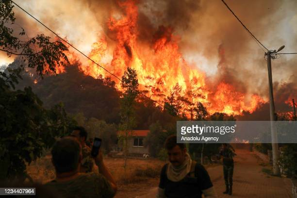 People help firefighters battle the forest fire broke out in Marmaris district of Mugla as ground and aerial extinguishing operations continue on...