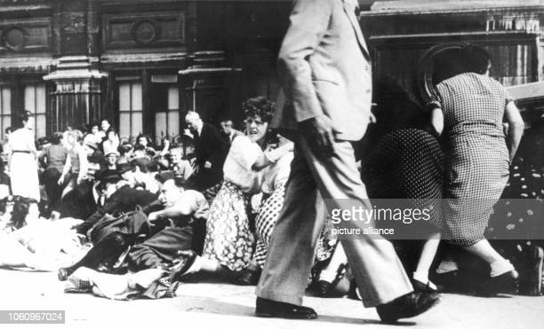 People hide on the Place de l'Hotel de Ville during a shooting shortly before the invasion of the American troops in August 1944 German commander...