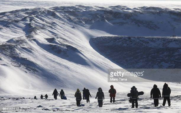 People hike near Thule Air Base on March 25 2017 in Pituffik Greenland NASA's Operation IceBridge is flying research missions out of Thule Air Base...
