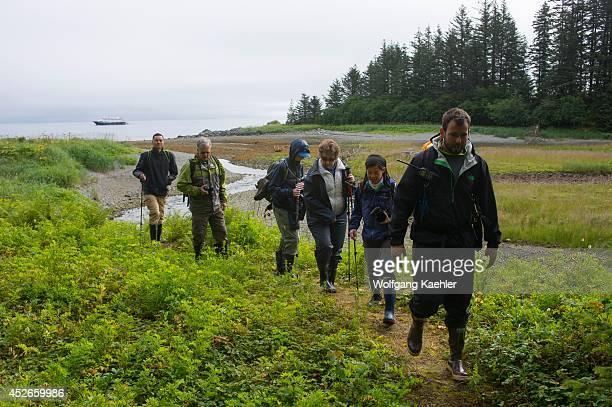 People hiking at Idaho Inlet on Chichagof Island, Tongass National Forest, Alaska, USA.