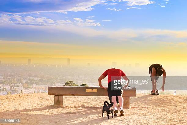 People hiking at sunset on Runyon Canyon, Hollywood Hills, California