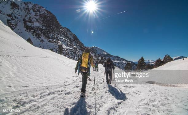 People hiking at the mountains during winter sunny day