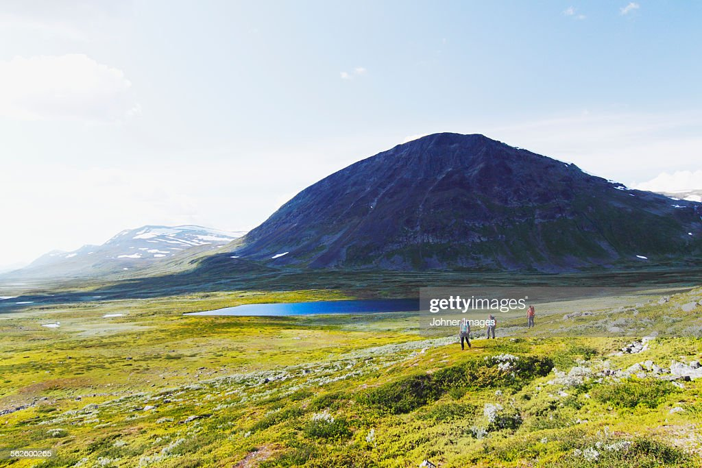 People hiking in mountains : Stock Photo