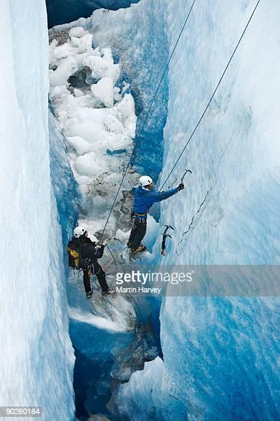 People hiking on frozen mountainside