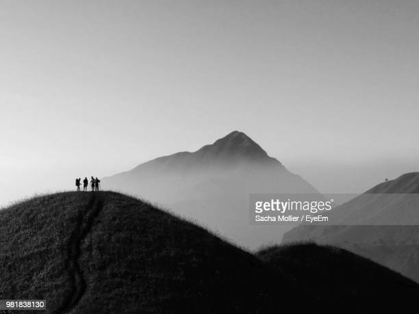 People Hiking On Mountain Against Sky