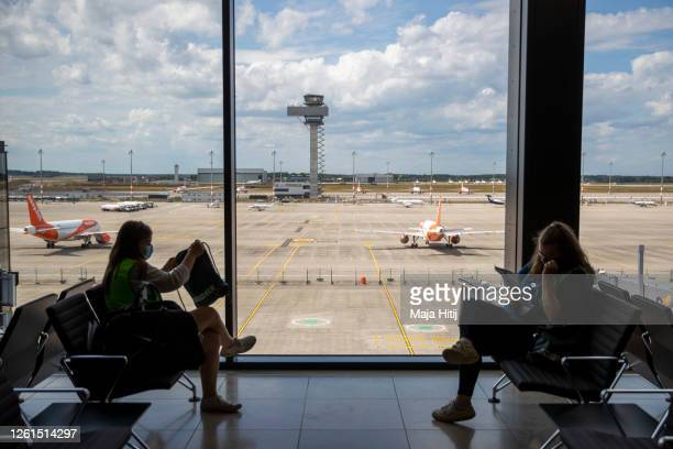 People hired for the day wait to board at the terminal during a trial run of the baggage system at Berlin Brandenburg Airport ahead of the new...