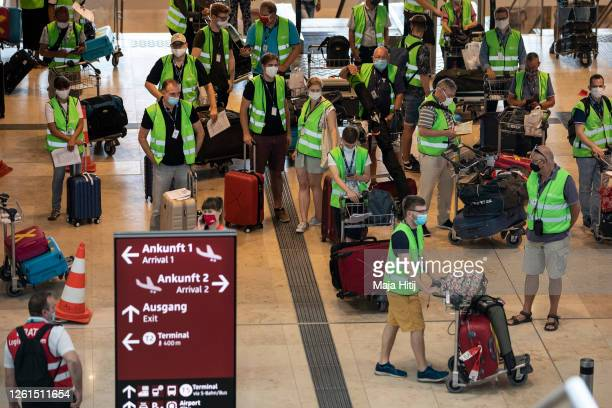 People hired for the day wait to enter terminal during a trial run of the baggage system at Berlin Brandenburg Airport ahead of the new airport's...
