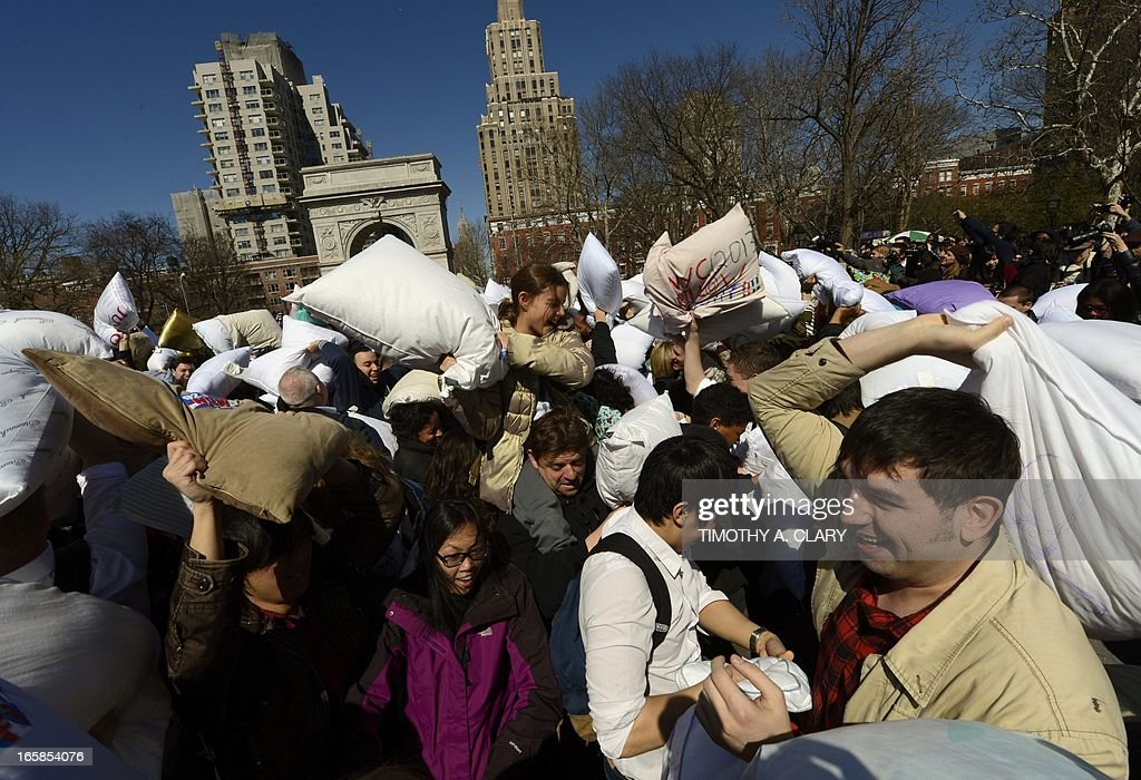People hit each other with pillows as they take part in the world's 6th annual Pillow Fight Day in Washington Square Park in New York on April 6, 2013. The massive pillow fight, which is the New York City's 8th annual, takes place in cities around the world.
