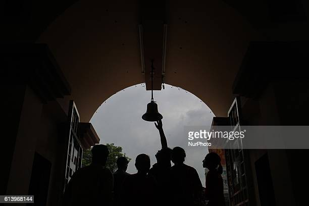 People hits the bell on the last day of Durga Puja at Dhakeshwari Temple Dhaka Bangladesh 11 October 2016