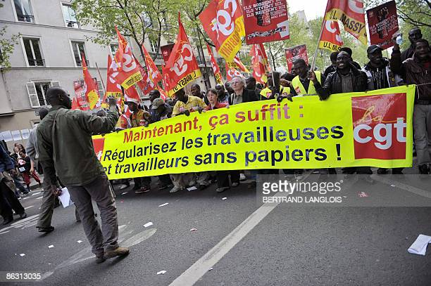 People hold a banner asking for the regularization of illegals during the traditional May Day demonstration on May 1 2009 in Paris as leftwing...