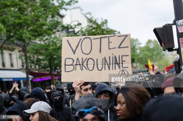 People hold a banner during a demonstration for a quotsocial first roundquot of the French presidential election on April 22 2017 on the place de la...