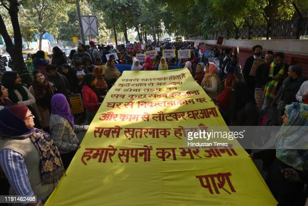 People hold a banner during a protest against the Citizenship Amendment Act at Jantar Mantar on January 3 2020 in New Delhi India The act seeks to...