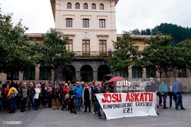 People hold a banner reading in Basque Freedom for Josu don't attack the solution during a demonstration in the Spanish Basque village of Miraballes...