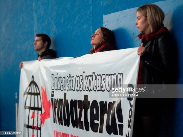 People hold a banner reading in Basque We will win peace and freedom Josu and the others free during demonstration in the village of Miraballes on...