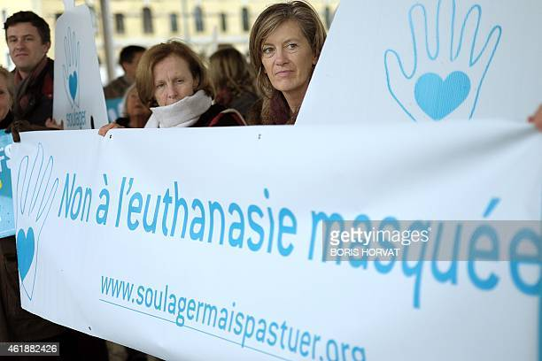 People hold a banner reading 'No to hidden euthanasia'' on January 21 2015 in Marseille to protest against euthanasia as the French Parliament is to...