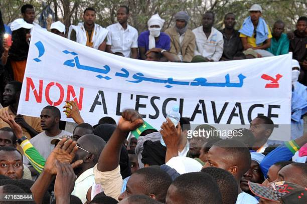 People hold a banner reading No to slavery during a demonstration against discrimination in Nouakchott on April 29 2015 Thousands of descendants of...