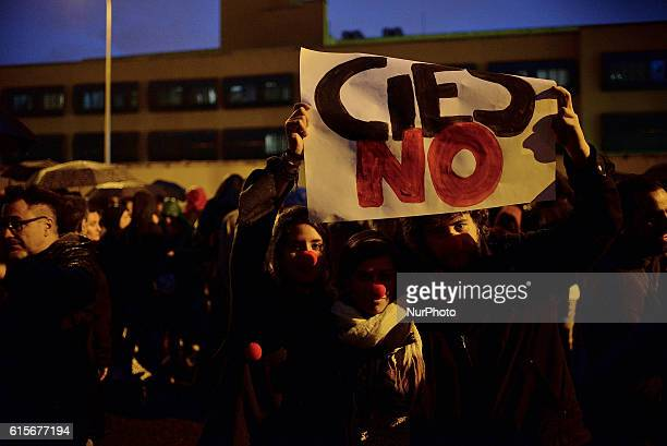 People hold a banner reading NOCIES during a rally in support of migrants and refugees in Aluche Madrid on October 19 2016 The civil protest held...