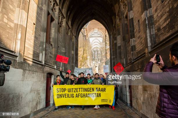 People hold a banner reading quotStop the expulsions of people to unsafe Afghanistanquot during a march on February 18 in the centre of Utrecht to...